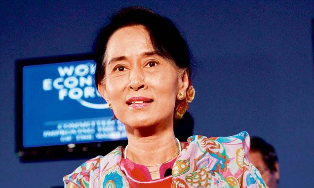 Myanmar's pro-democracy leader Aung San Suu Kyi arrives to BBC World Debate during World Economic Forum on East Asia in Naypyitaw