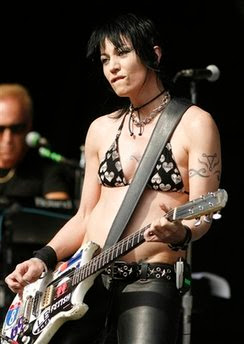This photo provided by Empire Expo Center, shows rocker Joan Jett performing one of two free concerts at the New York State Fair on Saturday, Aug. 23, 2008, in Geddes, N.Y. (AP Photo/Empire Expo Center, Mike Okoniewski) ** NO SALES **