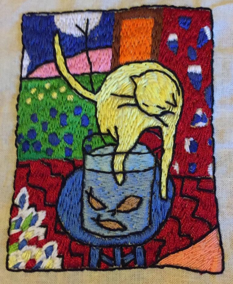 Gato y peces de colores bordado
